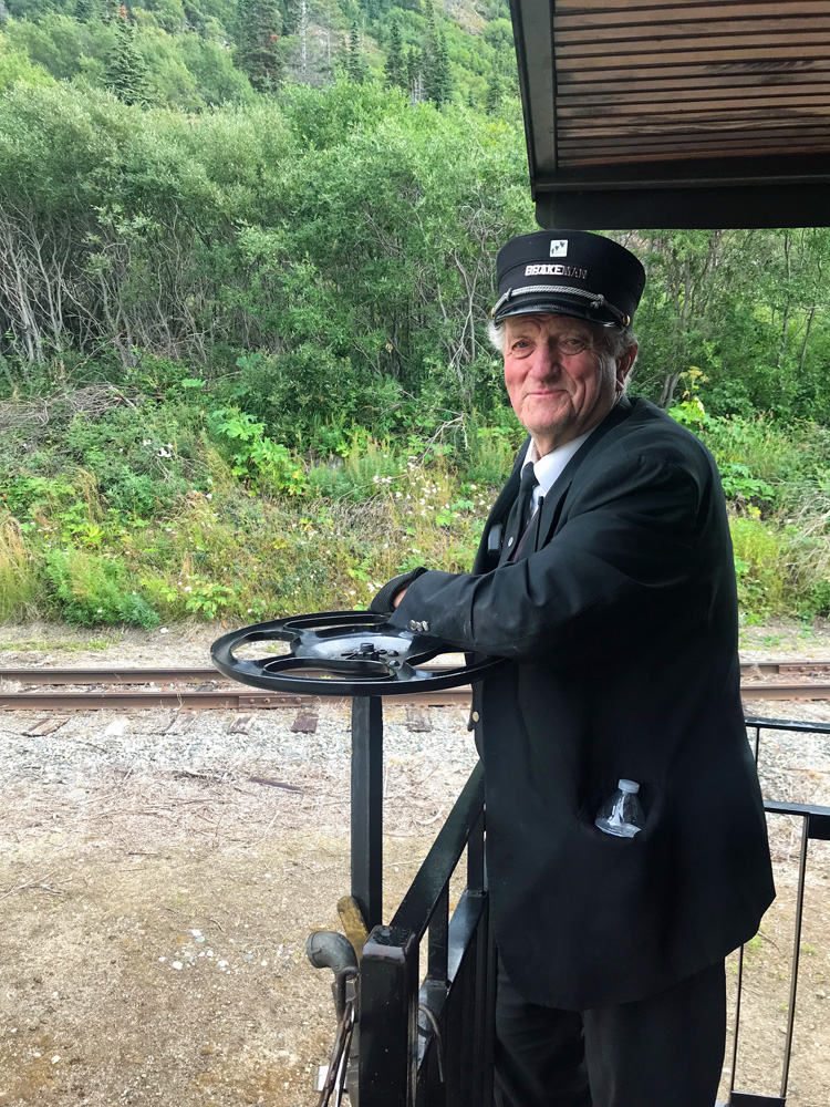 an image of a conductor on the White Pass and Yukon route train