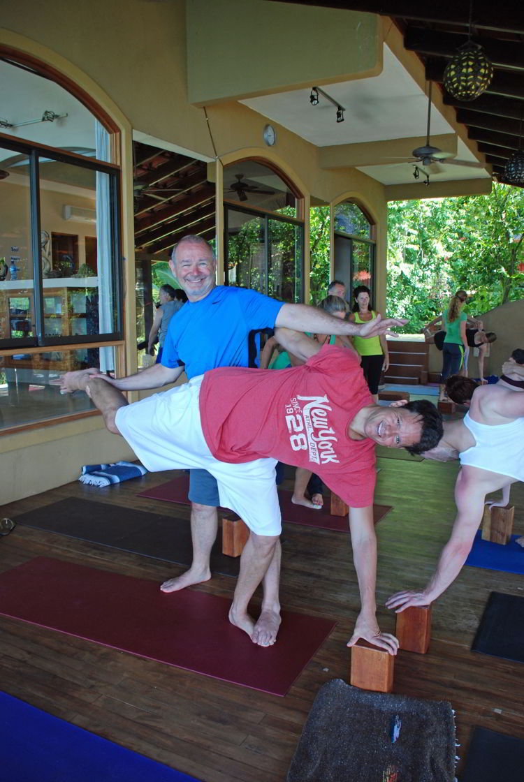 A pair of men doing yoga at Anamaya Resort in Costa Rica - Yoga Retreat Costa Rica