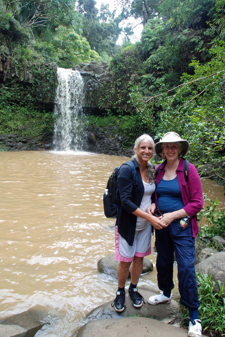 An image of two women standing in front of Twin Falls on the island of Maui, Hawaii - Hiking Maui