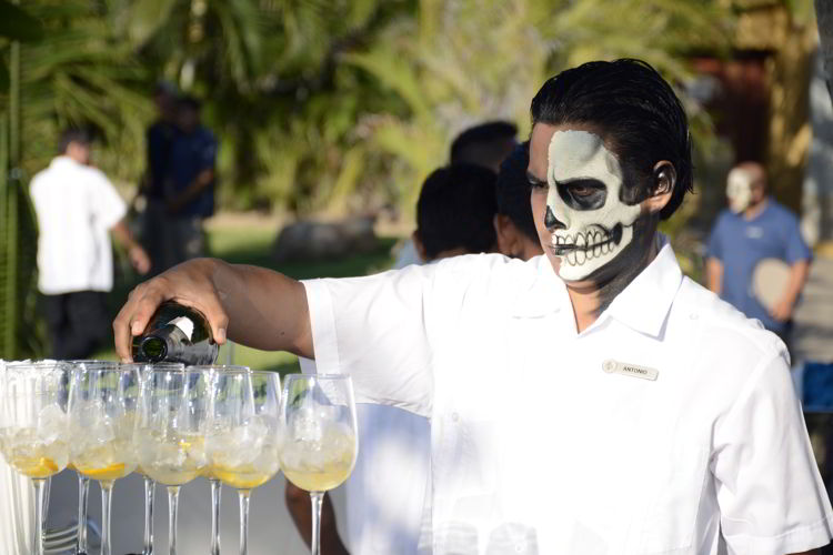 An image of a server with a skull painted on his face - Day of the Dead Festival -Dia de los Muertos