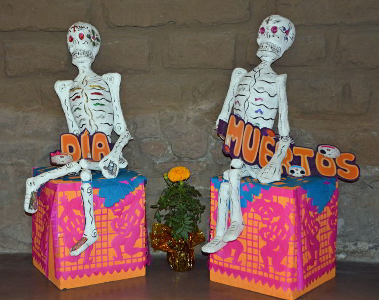 An image of two skeletons in a Day of the Dead Festival display - Dia de los Muertos