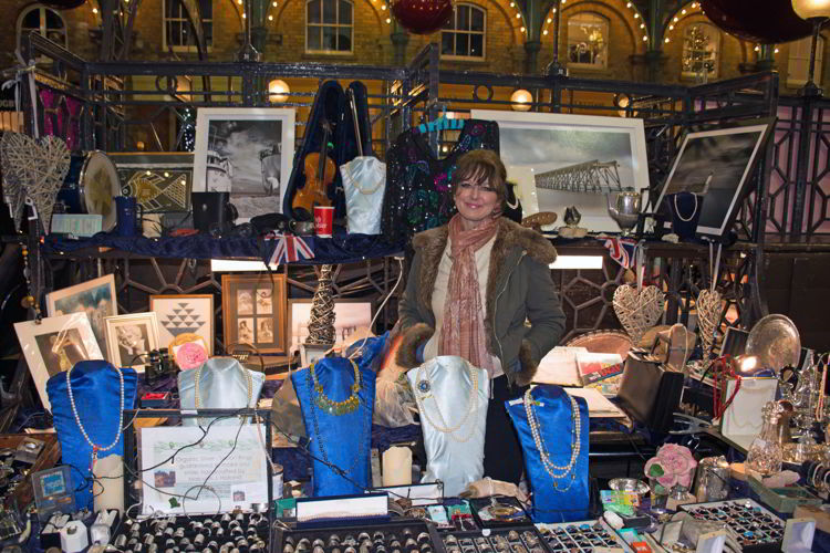 An image of a craft vendor at Covent Garden Christmas market in London - best Christmas markets