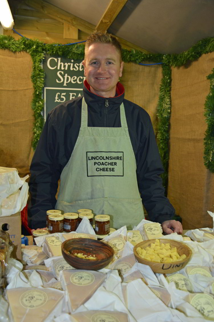 An image of a cheese vendor at the Lincoln Christmas market in Lincolnshire, England - best Christmas markets