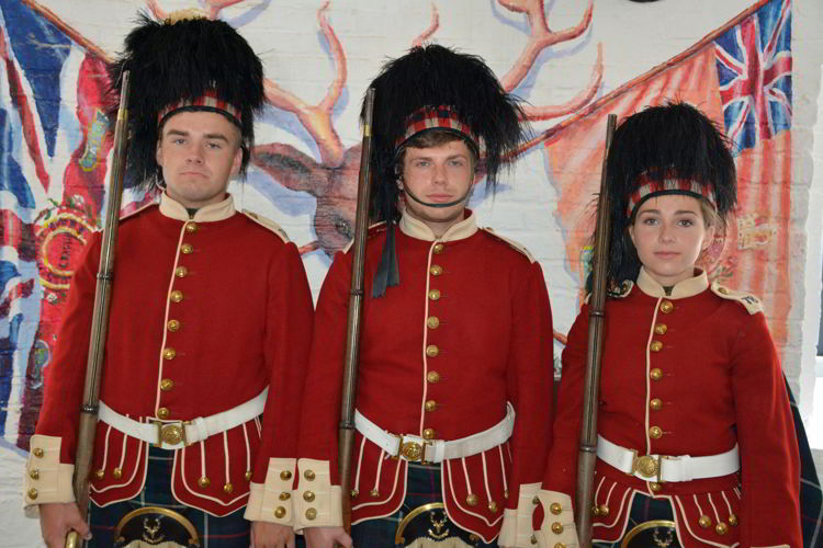An image of three people dressed as soldiers at the Halifax Citadel in Halifax, Nova Scotia Canada - Halifax Tours
