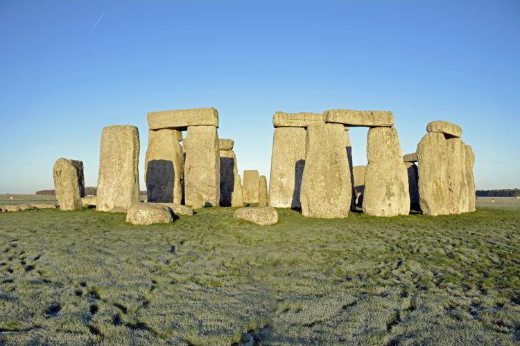 An image of Stonehenge bathed in morning light near Salisbury, UK - Stonehenge inner circle tours
