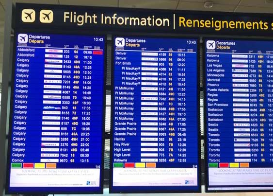 An image of an airport departures board showing Swoop airlines delayed - Swoop Airlines review