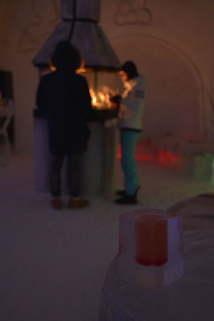 An image of the lounge area inside the Hôtel de Glace in Quebec, Canada - Ice Hotel Quebec