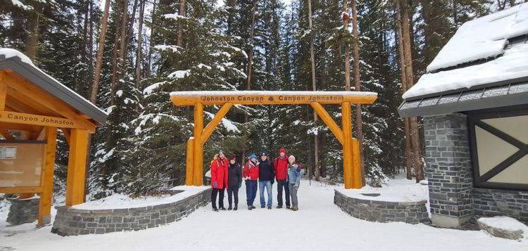 An image of a group of people at the Johnston Canyon trailhead in  Banff National Park, Alberta - Johnston Canyon Winter Hike and ink pots hike
