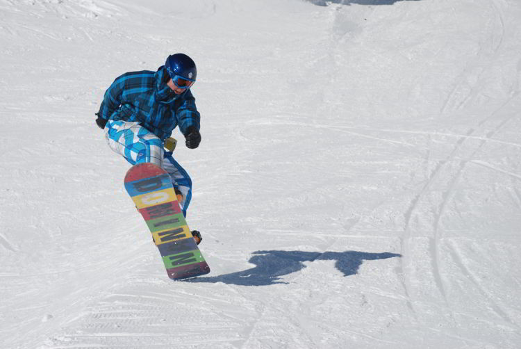 An image of a boy snowboarding at Canyon Ski Resort - things to do in Red Deer.