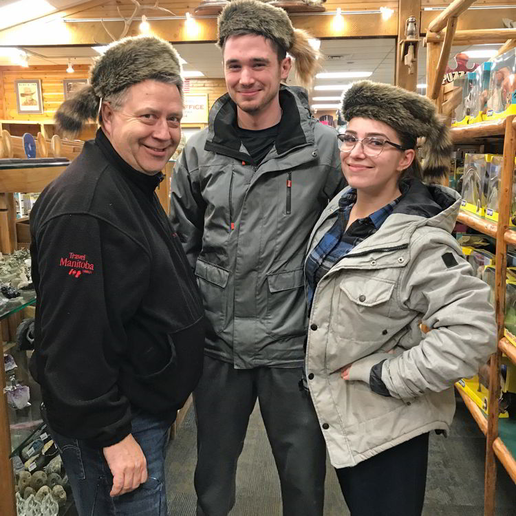 An image of three people wearing coonskin hats at Ruby's Inn General Store in Bryce Canyon City, Utah - Bryce Canyon in winter