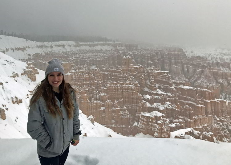 An image of a person standing in front of the Sunrise Point Overlook in Bryce Canyon National Park, Utah - Bryce Canyon in winter