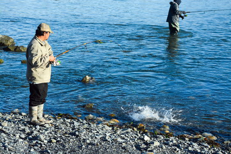 An image of two men fishing from shore in Seward, Alaska - Things to do in Seward, Alaska