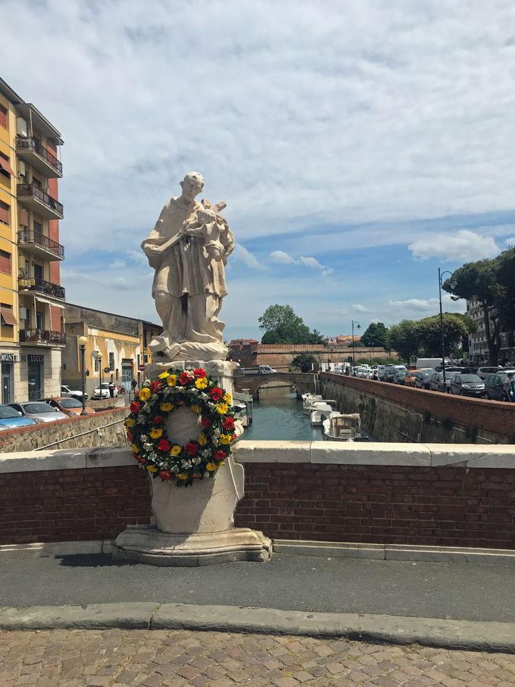 An image of a statue in Venezia Nuovo or New Venice in LIvorno, Italy.