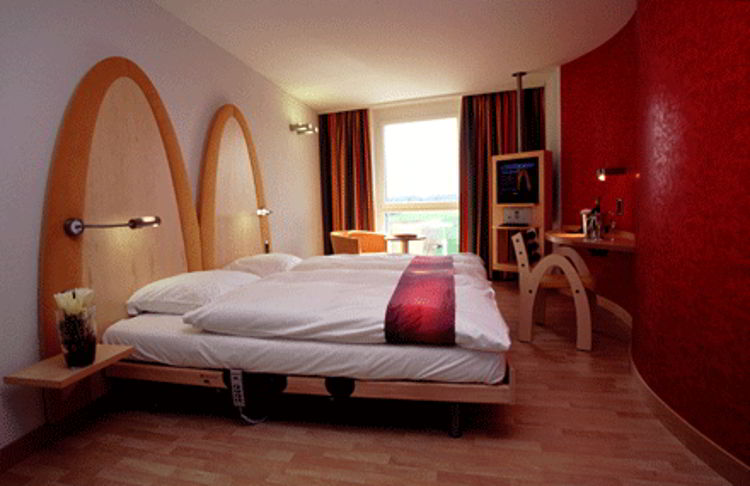 An image of the room design of McDonalds Golden Arches hotel in Swizerland.