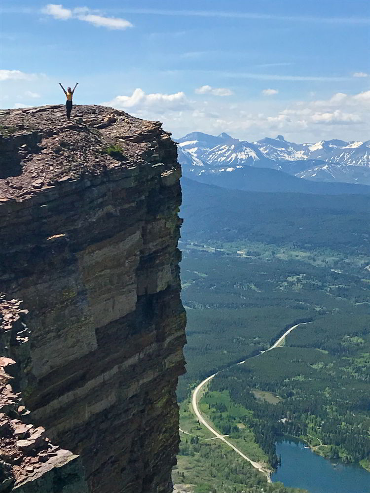 An image of a your woman standing at the top of Table Mountain, Alberta.