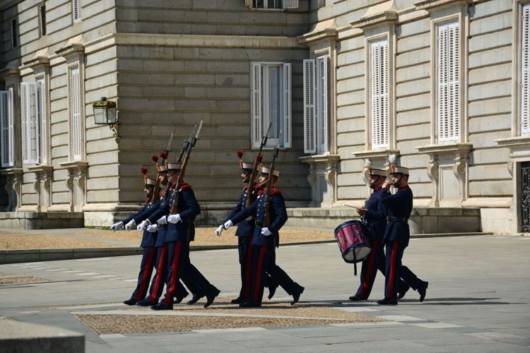 An image of the changing of the guard ceremony in front of the Royal Castle Madrid, Spain.
