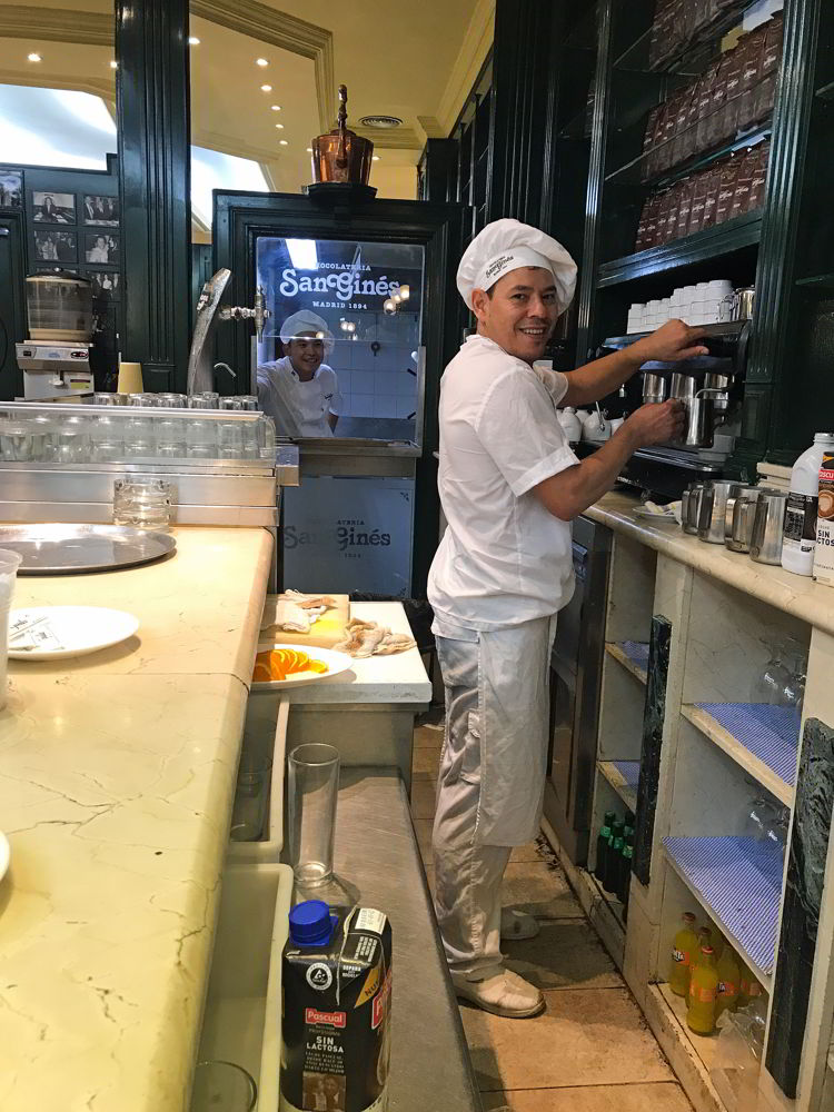 An image of two workers at Chocolateria San Giles in Madrid, Spain.