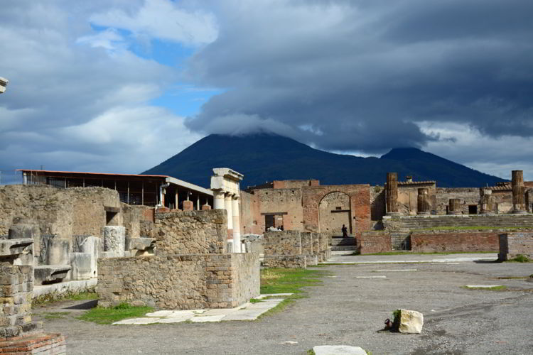 An image of Pompeii with Mount Vesuvius in the background.