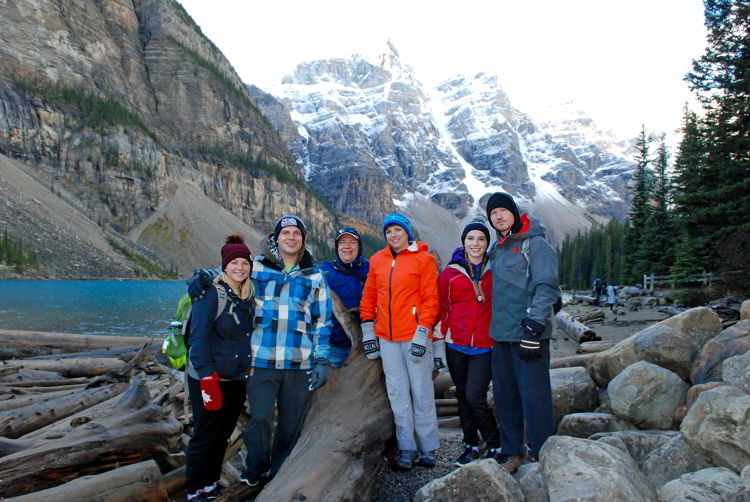 An image of a group of people standing in front of Moraine Lake in Banff National Park.
