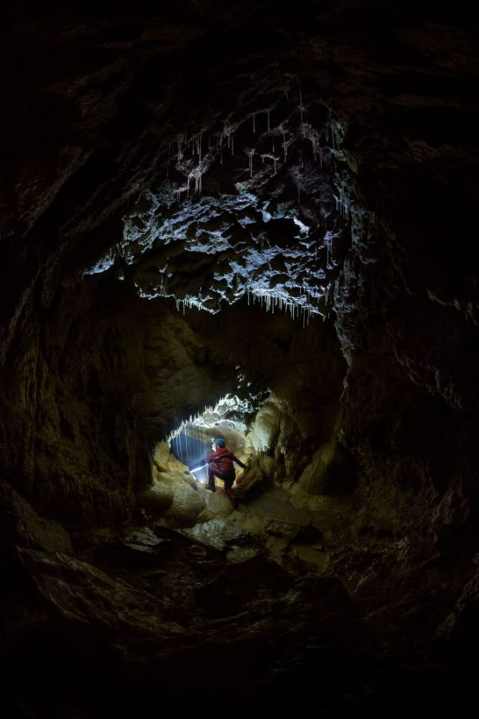 An image of a person inside the Rat's Nest Cave near Canmore, Alberta Canada.