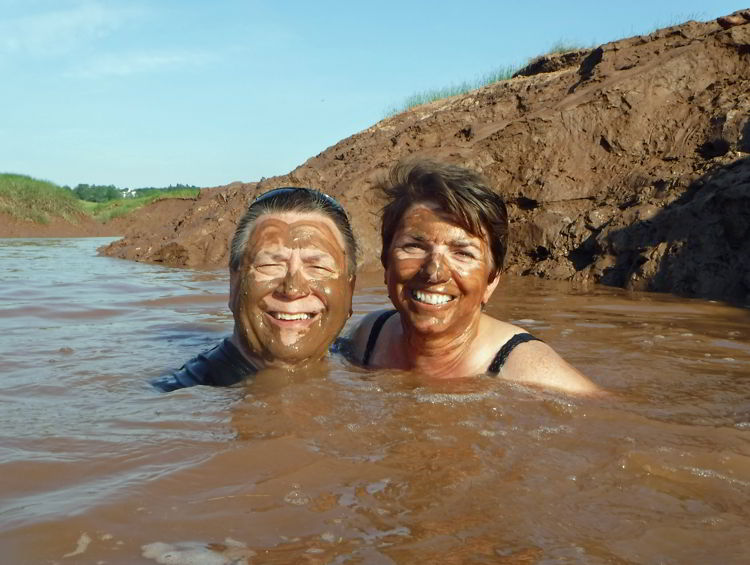 A picture of two people swimming in the muddy Schubenacadie River  in Nova Scotia.