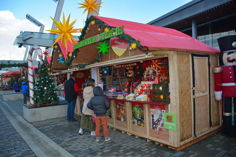 An image of people shopping at a booth at the German Christmas Market in Vancouver, BC, Canada.