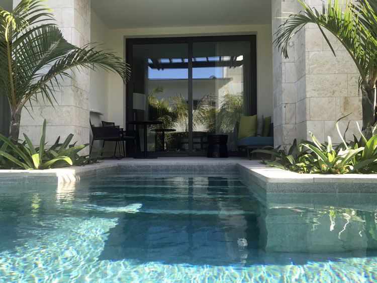 An image of the outside of the swim up junior suite at the Lopesan Costa Bavaro resort in Punta Cana, Dominican Republic.