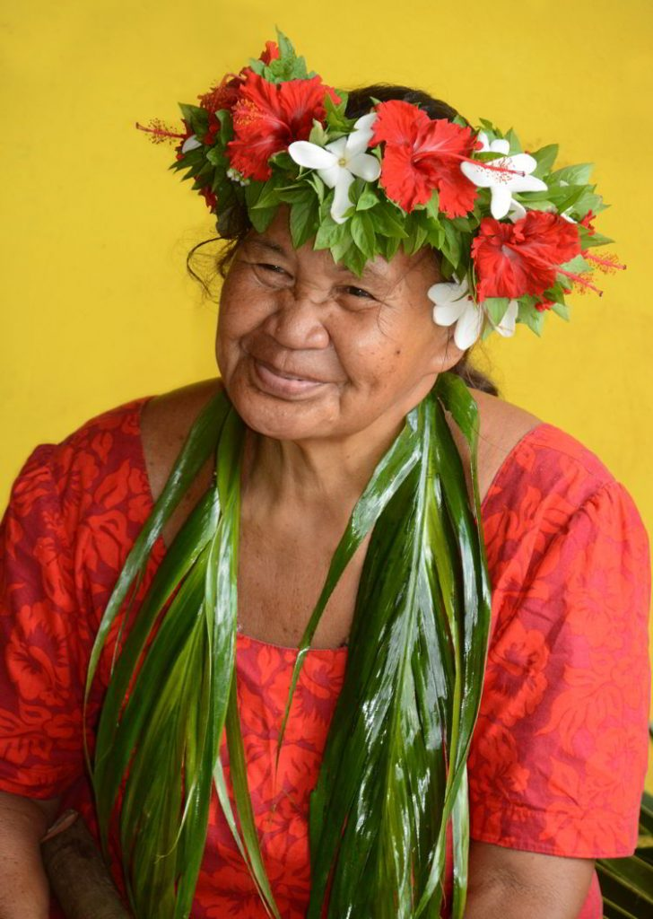 An image of an elderly Polynesian woman with a flower crown on the island of Fatu Hiva in the Marquesas Islands of French Polynesia.