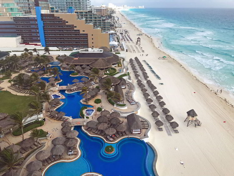 An image of the beach at the Marriott Cancun Resort in Cancun, Mexico - Travel More and Pay less.