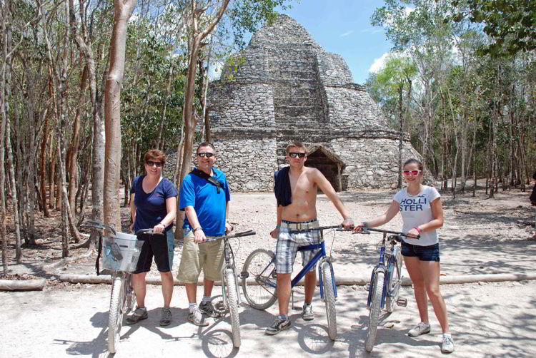 An image of a group of people on bicycles in the Coba ruins of Mexico.