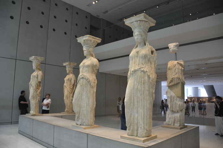An image of statues in the Acropolis museum in Athens, Greece.