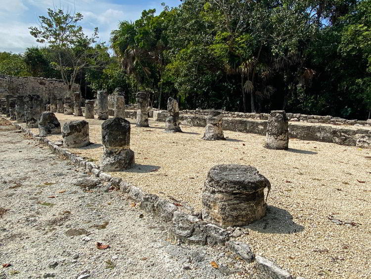 An image of some columns at the El Meco archaeological site in Cancun, Mexico.