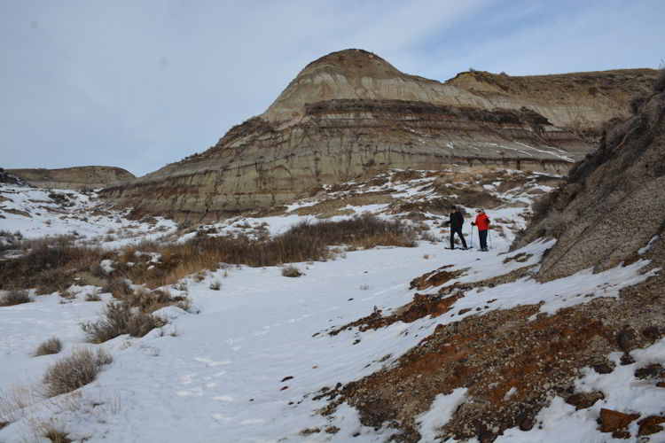 An image of two people hiking through the badlands - Red Deer River Adventures - Drumheller, Alberta