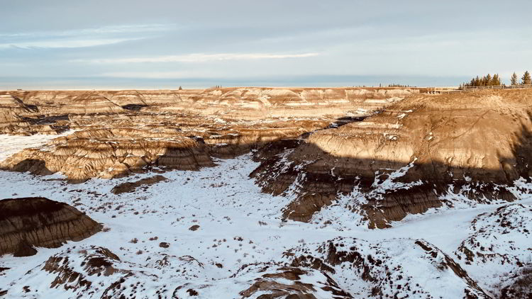An image of the view from Horseshoe Canyon Overlook during the winter at sunset - Alberta