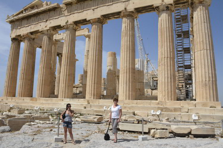 An image of two women standing in front of the Parthenon in Athens, Greece.