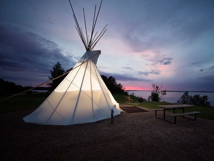 An image of a comfort camping tipi at Sir Winston Churchill Provincial Park in Alberta, Canada.