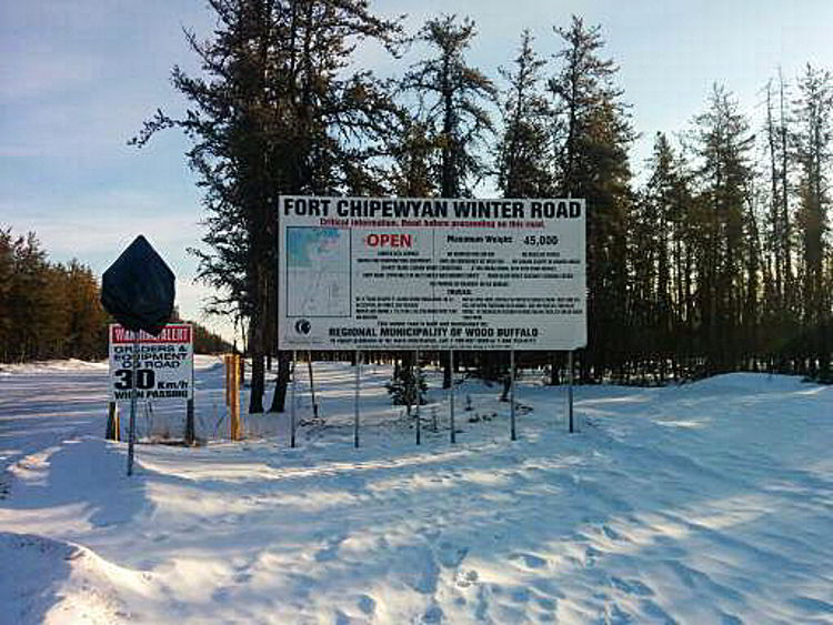 An image of the winter road sign for Fort Chipewyan - alberta winter road trips.