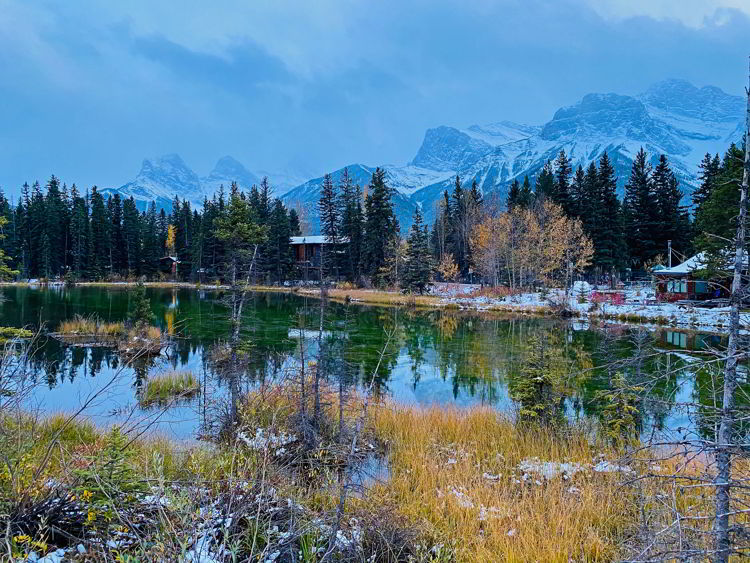 An image of a pond seen from a walking trail in Canmore - Canmore winter hikes and snowshoe trails.