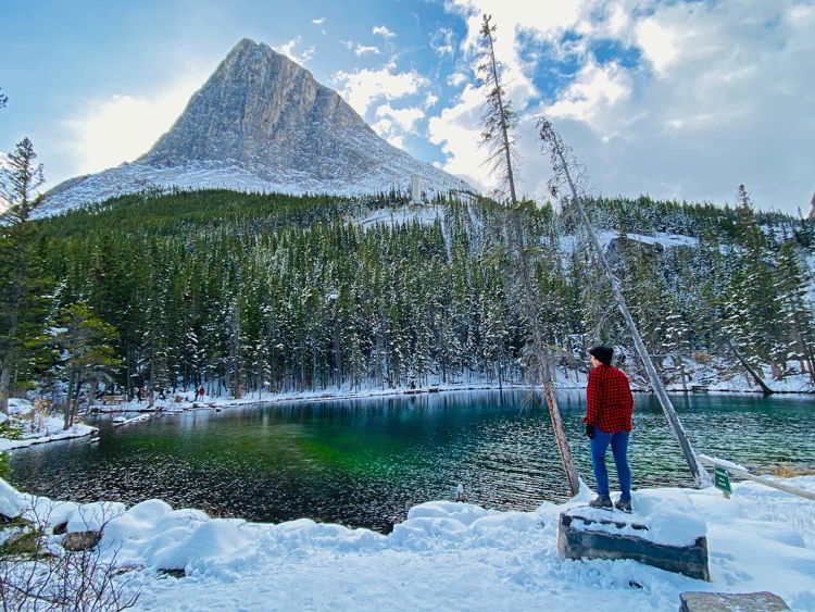 An image of a woman at Grassi Lakes - Canmore winter hikes and snowshoe trails.
